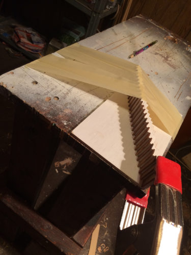 stairs clamped to wall while glue dries